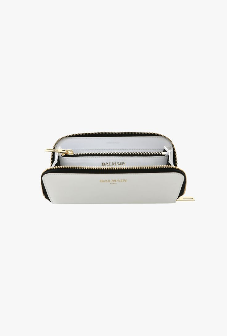 Crafted in Italy from smooth leather, this wallet has several card and bill slots and a zipped coin pocket. This smart style will work perfectly with your every day bag.