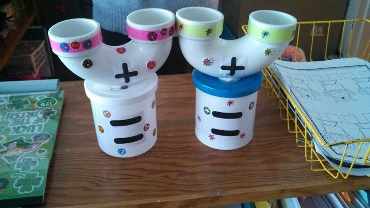 Adding machines. Don't have the tools to drill holes into PVC pipes but love the idea of recycling frosting cans for this.