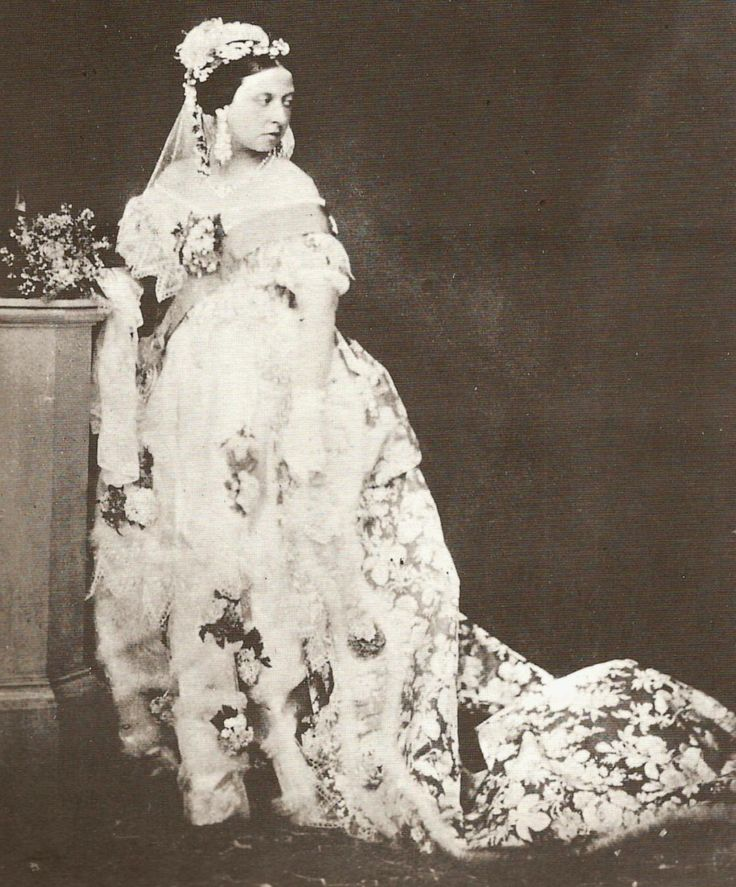 """Queen Victoria in her wedding dress. White satin, trimmed with Honiton lace, with Honiton long veil and a wreath of orange blossoms to represent purity. """"It was then that white became the dominant, traditional choice, symbolizing purity and maidenhood."""" – Emma's Wedding Diary. 1840. #royalty"""
