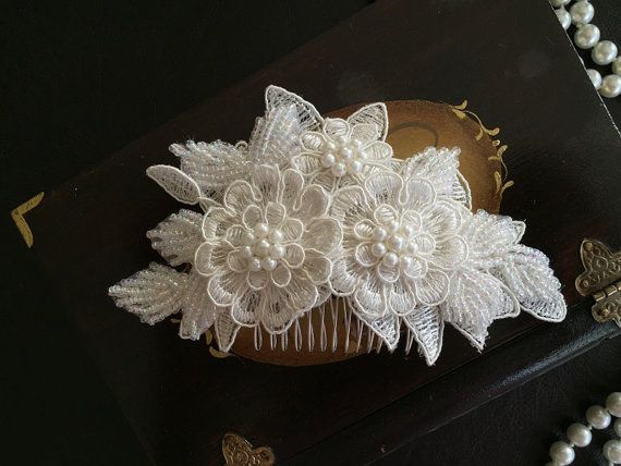 The comb feautures ivory lace, pearl and comb. Please let me know your wedding date also, so the packages arrive in time. All hair accessories are
