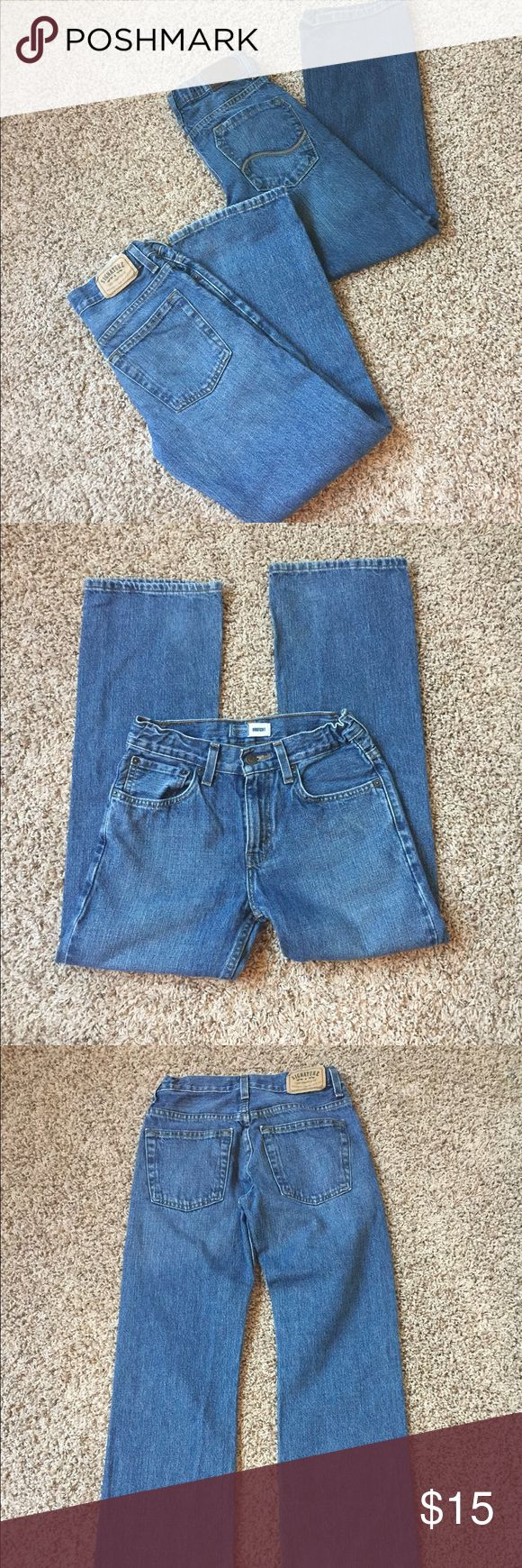 Two Pair Boy's Jeans Size 12 Both Jeans are Size 12 Regular. Lee Dungarees and Levi's Signature with adjustable waists. Lee pair has a couple of worn spots on knees. Levi's are in excellent preowned condition- no flaws noted. Smoke free home. Signature by Levi Strauss Bottoms Jeans