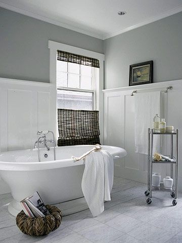 Timeless White Bath- Timeless white woodwork and cool marble floors complement the vintage style of the handsome soaking bathtub in this large bathroom. Notice how the paneling and picture rail bring down the height of the room and complement the scale of the bathtub, giving the room a finished look even though it's lightly furnished > love the high wainscoting - then use the ledge for decorations