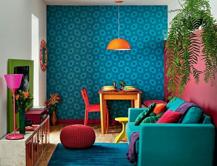 Bright n colorful room been revitalisd by blu wallcover