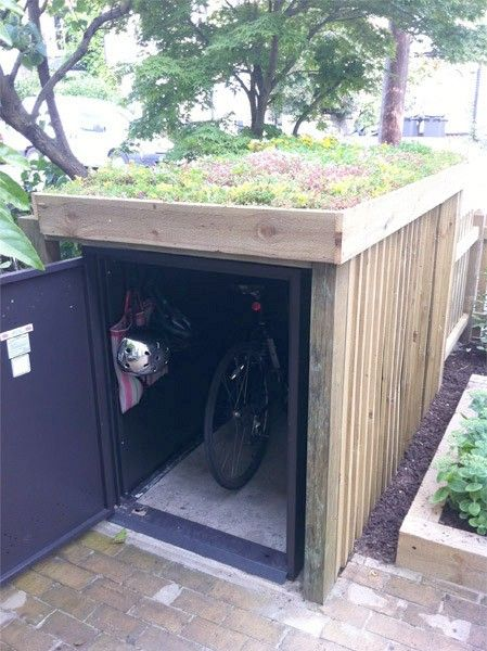 bike locker with rooftop garden - only instead, a kayak shed with a green roof!