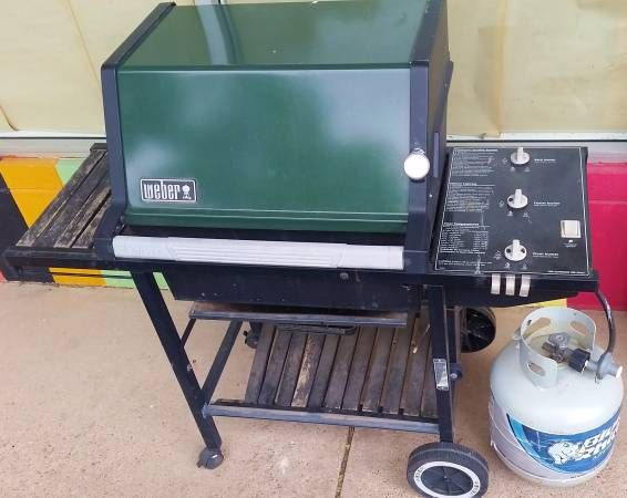 green vintage weber gas grill