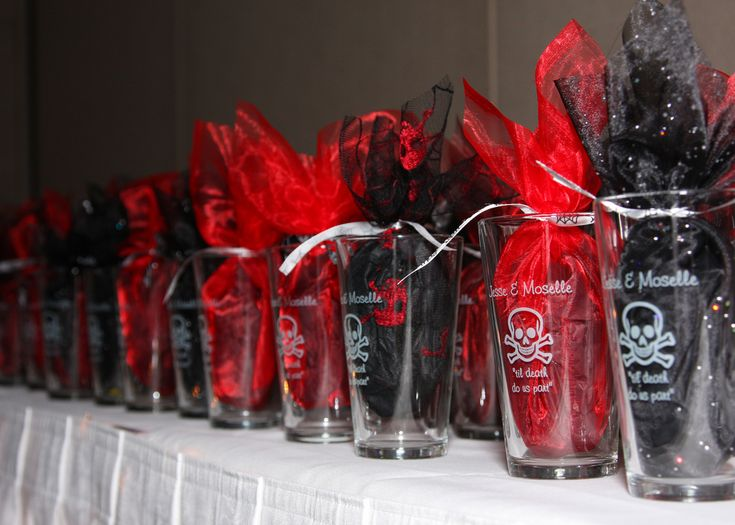 Personalized skeleton pint glasses. Put the names of the bride and groom on them for