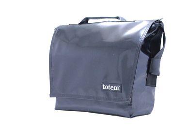 The Hip City Messenger Bag- Black- $155 (http://www.totembags.ca/t3-hip-city-messenger-bag-black/)