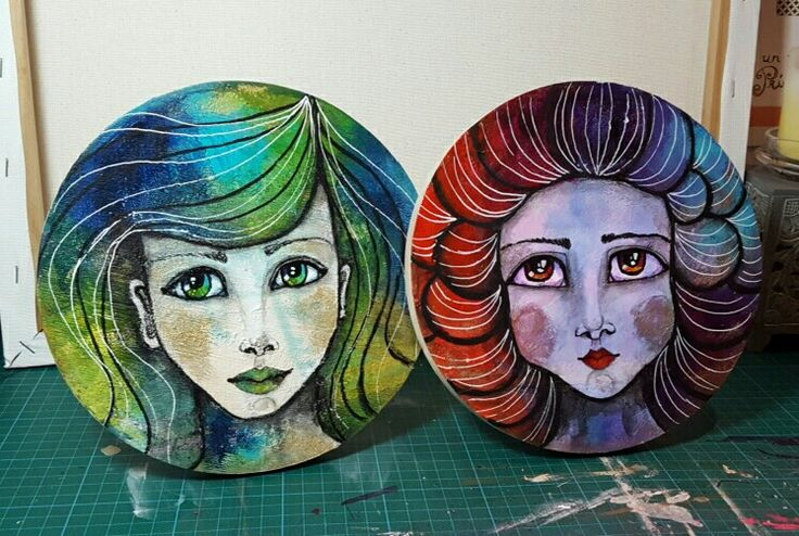 Girls faces on wood