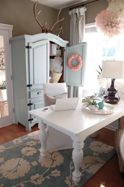 Feminine working space. Love the table leg detailing and the antlers. And the pink wreath