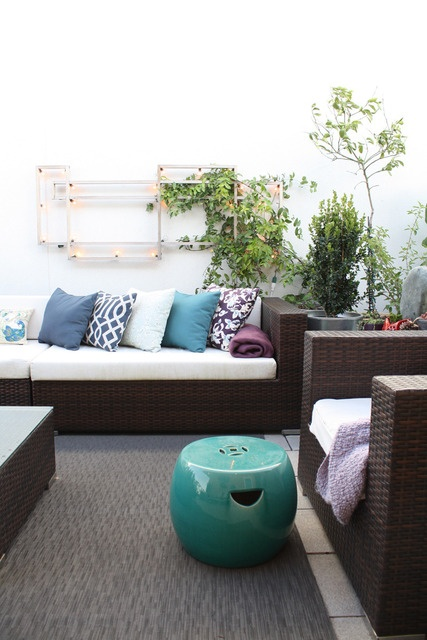 modern outdoor sofa w/ outdoor pillows, garden stools as side tables/ extra seating. I like that this garden stool has handles
