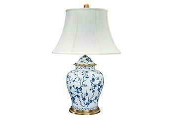 Classically designed and inspired by Eastern motifs, this temple jar lamp is made of hand-painted and embossed porcelain in an indigo-and-cream cherry blossom motif.