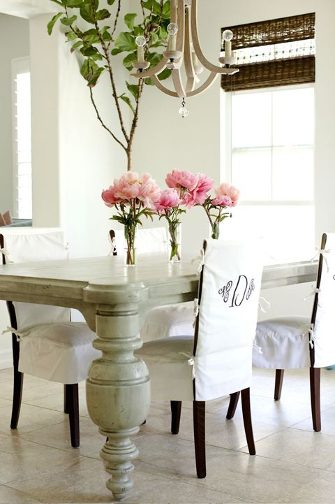 White Chunky Table Brown Chairs With Monogrammed Slipcovers Flowers Window Coverings