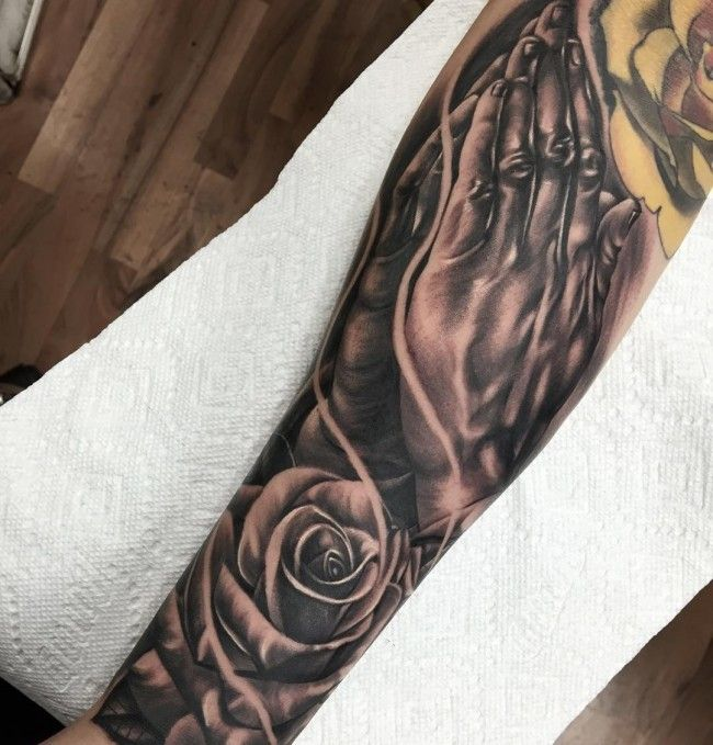 Praying hands and rose tattoo