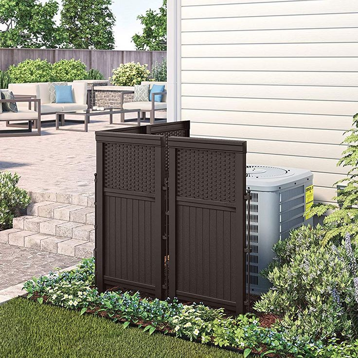 The outdoor privacy screen keeps trash cans, air