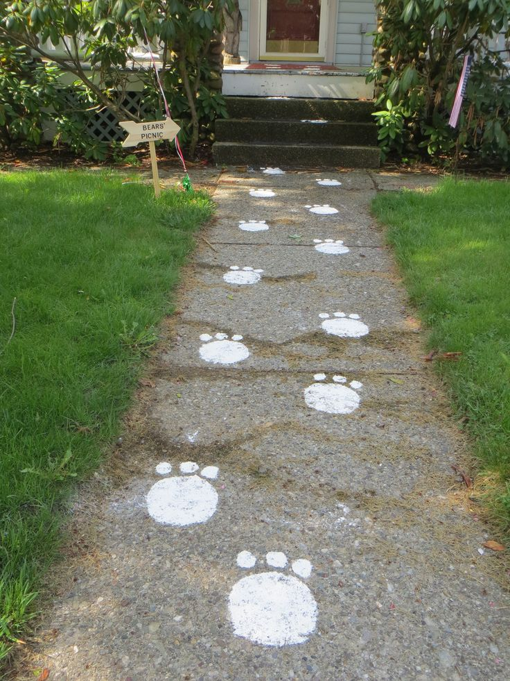 Teddy Bear Picnic Themed Party- bear paw prints made with a stencil and flour.