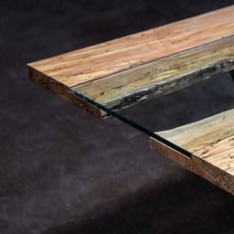 The colors and design of the SENTIENT Colorado modern dining table suggest the south west United States. The glass-filled gap between the edges of a live edge spalted maple slab suggest a great river,