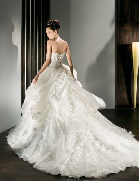 Demetrios bridal gown: I love the long train and corset top!
