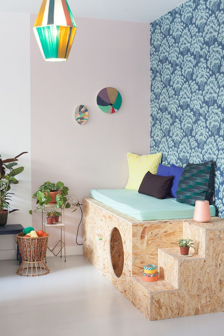 Now I'm not sure if this is meant to be a kid-space, but I'd totally create that daybed with a hidey hole for my pup!