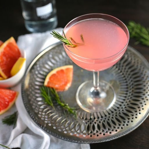 The French Tart (grapefruit, Elderflower And Rosemary Cocktail) With Vodka, Liquor, Pink Grapefruit Juice, Lemon Juice, Simple Syrup