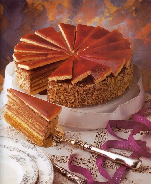 "Dobos Torta ""Drummer's Cake"" ~ It is a five-layer sponge cake, layered with chocolate buttercream and topped with thin glassy caramel slices. The sides of the cake are sometimes coated with ground hazelnuts, chestnuts, walnuts or almonds but the original cake is uncoated. Dobos' aim was to make a cake that would last longer than other pastries, in an age when cooling techniques were limited. The caramel topping helps keep the cake from drying out. #Budapest #Dobos-Torta"