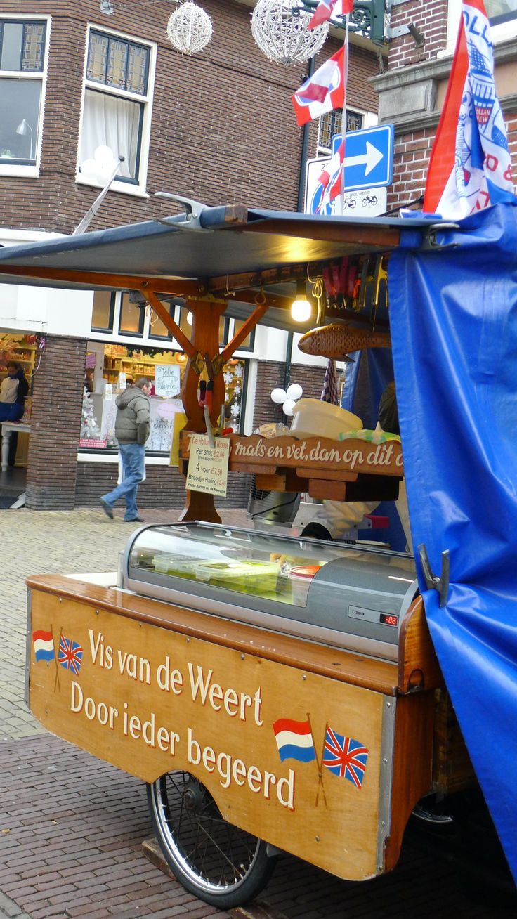 """typical dutch """"hapjes"""". Street vendor of Zoute Haring"""", Salted Herring (raw & pickled)"""