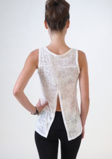 This fun, lightweight burnout top is so flattering and versatile. The open back gracefully flows with every movement. White.  COMING SOON