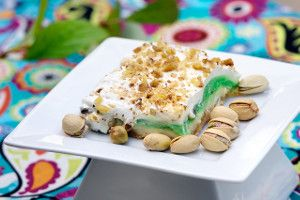 Old School Pistachio Cake - This quick and easy pudding cake recipe comes from the recipe box of old favorite family recipes. Old School Pistachio Cake uses Bisquick mix for the crust, topped with layers of light cream cheese, pistachio pudding, and Cool Whip. Yum!