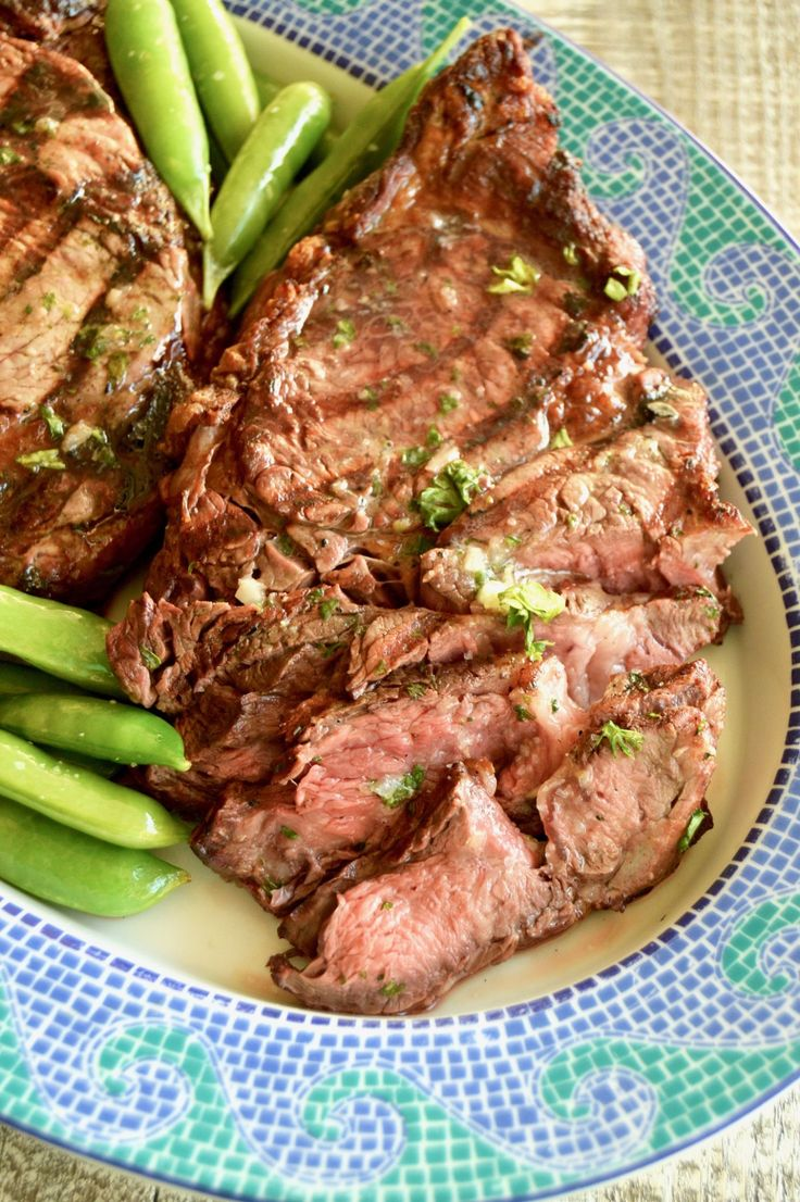 Grilled Steak with Bourbon Garlic Butter-- How to grill the perfect steak: Melted Bourbon Garlic butter blankets seared on the outside, juicy, tender on the inside steaks for an easy BBQ meal for entertaining.