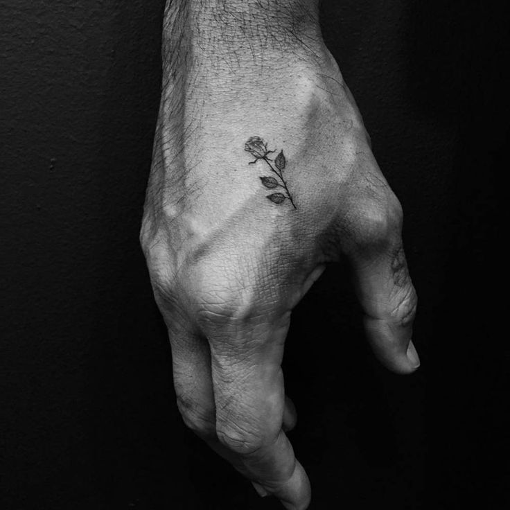 Small rose tattoo on the right hand. Tattoo... - Little Tattoos for Men and Women