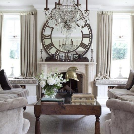 The large clock/mirror distracts from the window seats on either side of fireplace.  NICE.  http://hominspire.com/wp-content/uploads/2012/06/french-elegant-living-room.jpg