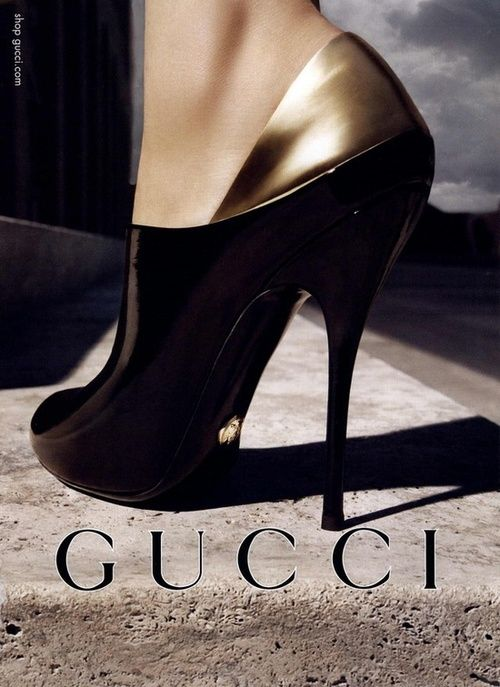 Imgend Gucci black and gold heels Id never go anywhere posh enough to wear these but they would look great in my closet