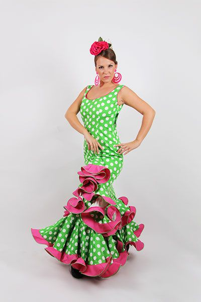 Trajes de flamenca Oferta Orquidea de color verde pistacho con lunares blancos y los volantes en fucsia, de talle bajo con subida lateral y mangas de tirantes. http://www.elrocio.es/41-trajes-de-flamenca-baratos