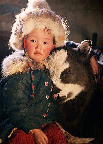 Child and Yak calf in Mongolia