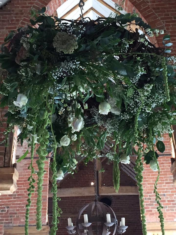 floral wreath hanging from pulleys in @shustokefarmbarns by @pennyjohnsonflowers  #weddingflowers #warwickshireflorist #birminghamflorist #shustokefarmbarns #floralwreath #hangingdisplay #ceilingfloral