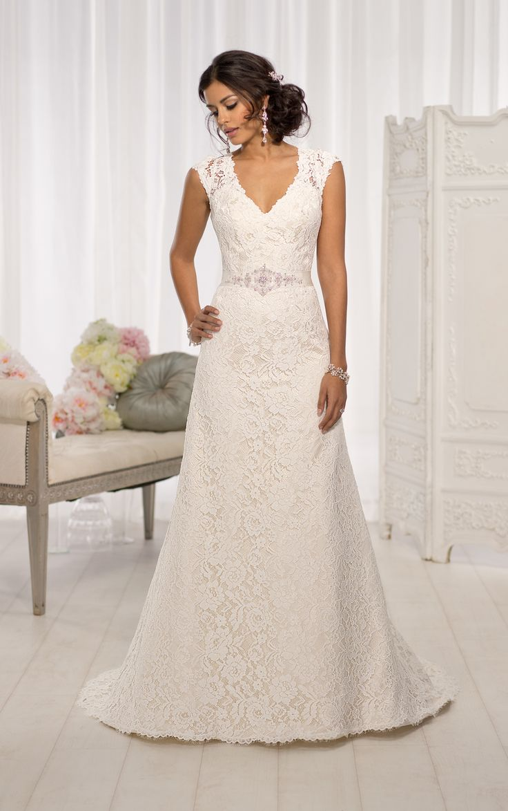 Elegant cap sleeve wedding dresses feature a gorgeous Lace over Dolce Satin A-line silhouette. Exclusive designer cap sleeve wedding dresses by Essense of Australia.