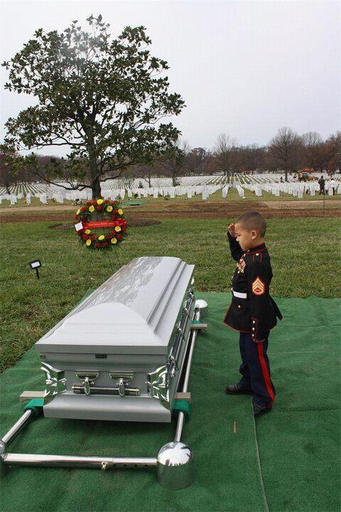 I do not know this little boy or his family but I have shed tears for them today. Something we should never forget is that some people give everything and more so we can be free. This little boy is a shining example of that sacrifice that his father made for us all. I will pray for him and his family and ask God to bless them all and give them the strength to carry on. One day this little boy will join his father in Heaven and never have to let him go again. God Bless Them!!