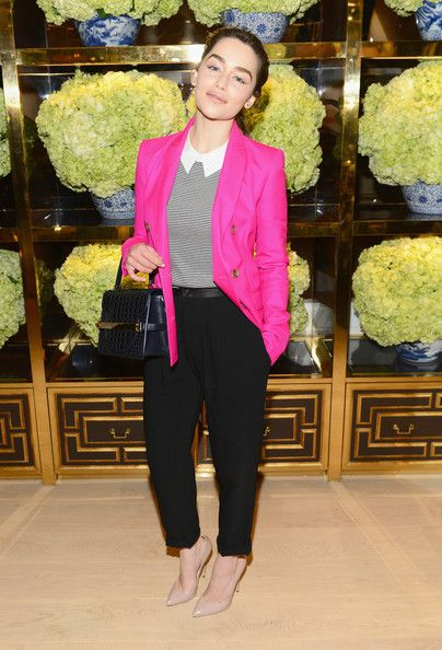 Emilia Clarke went for a bold look at Tory Burch with a hot pink blazer