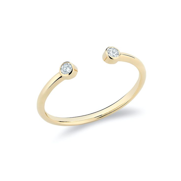 Twin ring with diamonds set in 18K gold.