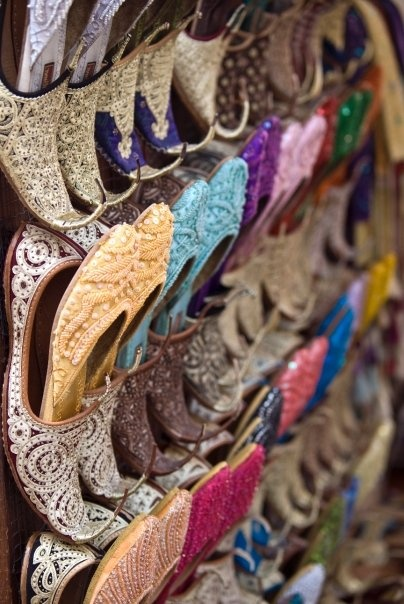 Colourful shoes for sale at the Souks in Dubai.