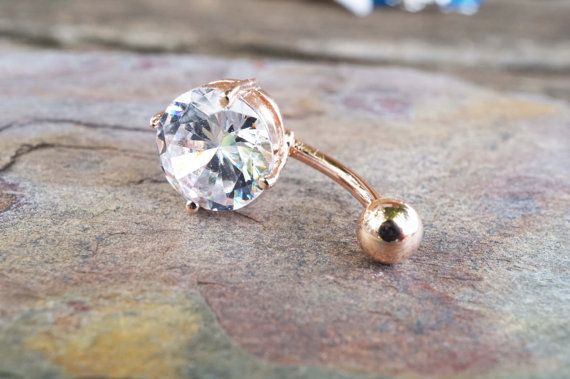 Belly button rings simple rose gold belly button jewelry with a 10mm round clear crystal. Belly button rings barbell is 14 gauge and 3/8 long, the