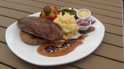 angus ramp steak with herbriced filled tomato and potato mash