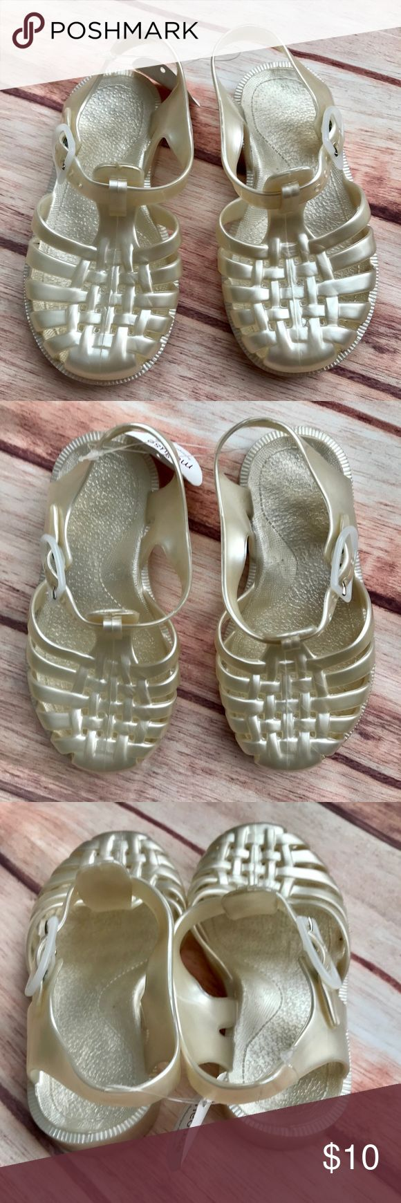 Sun Jellies Jelly Sandals - Girls EU size 25. Sun Jellies is located in the UK. Shoes are pearl, almost goldish color. Sun Jellies Shoes Sandals & Flip Flops