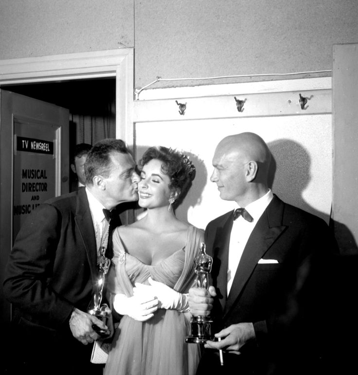 Mike Todd, Elizabeth Taylor and Yul Brynner at the 29th Academy Awards, 1957.