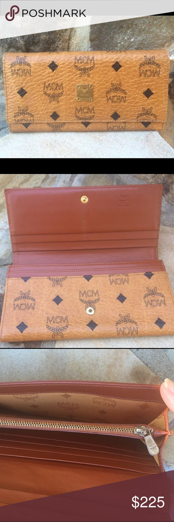 MCM Large logo Leather Wallet-Excellent Made Italy MCM large wallet lots of storage-10 slots for CC - 3 Large Slots and one zip spot for change- snap closure- Love this Excellent Condition. Made in Italy MCM Bags Wallets