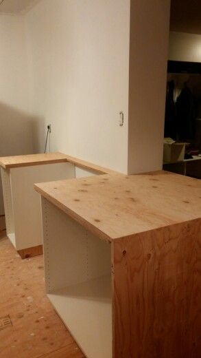 """Countertops going in, still to be laminated hand made by my husband. There will be a """"waterfall"""" feature for the countertops."""