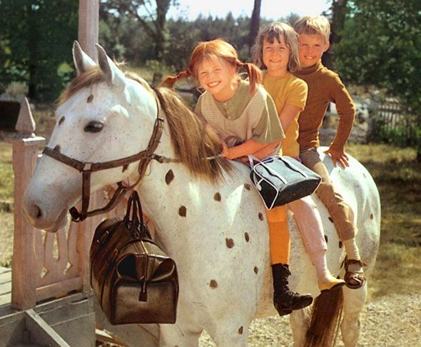 Pippi Langstrømpe and her two friends (neighbor kids) riding her horse (cannot remember the name), and with the bag of gold coins which Pippi is living of. Photo, Dear childhood memories.