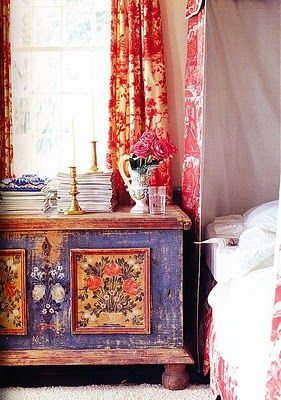 this is like my bedroom growing up- red toille and periwinkle purple