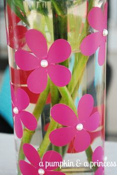 Glass vase with flowers cut with Cricut and little pearls glued on