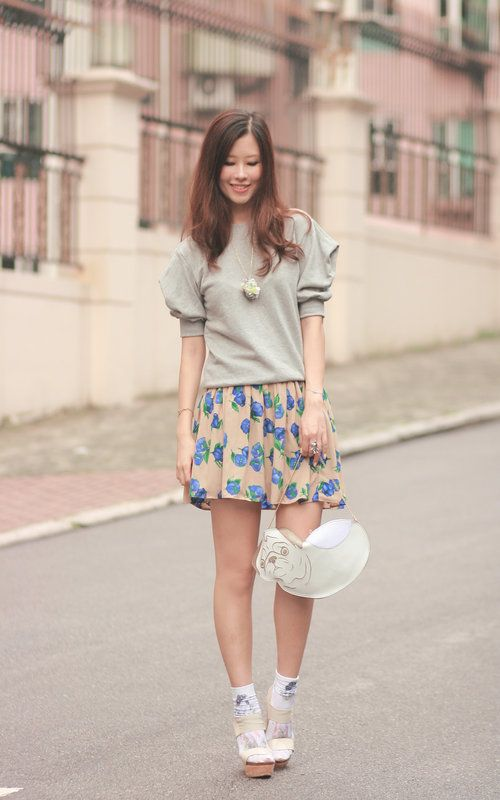 White patterned ankle socks, beige wedge sandals, clear brown and blue flowered skirt, grey sweat