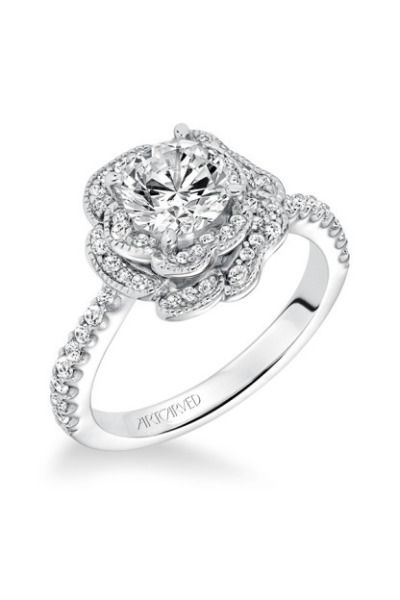 This unique rose ring from Artcarved is made completely of diamonds: http://www.stylemepretty.com/2014/11/01/30-of-our-most-coveted-engagement-rings/